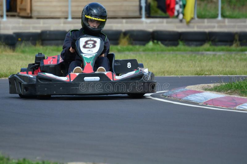 Go Karting Race. Amateur go kart racing. Taking the best line on the bend of the race circuit royalty free stock photo