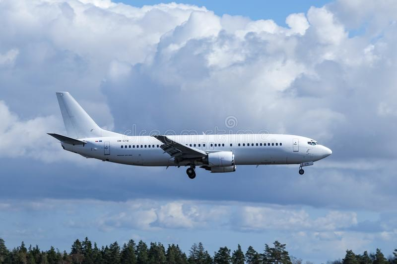 Go2Sky Slovak charter airline, Boeing 737 - 49R. Arlanda, Stockholm, Sweden - April 27, 2018: Go2Sky Slovak charter airline, Boeing 737-49R fly by and landing at royalty free stock photos