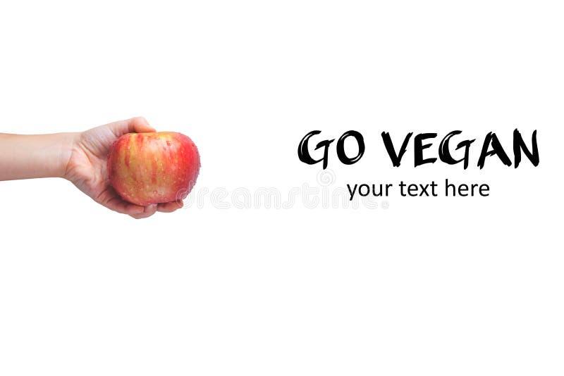 Go vegan! Concept of veganism. Vegan diet. Human hand with appl stock images