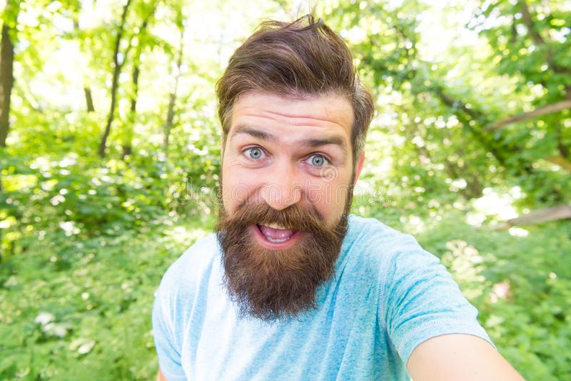 Go wild. Hair care male beauty. Summer fun. Bearded guy in park forest. Bearded hipster. Crazy bearded man in natural royalty free stock image