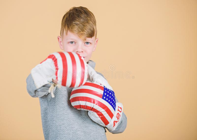 Go wild. usa independence day. Happy child sportsman in boxing gloves. Sport success. sportswear. Fitness diet. energy. Health. workout of small boy boxer royalty free stock images