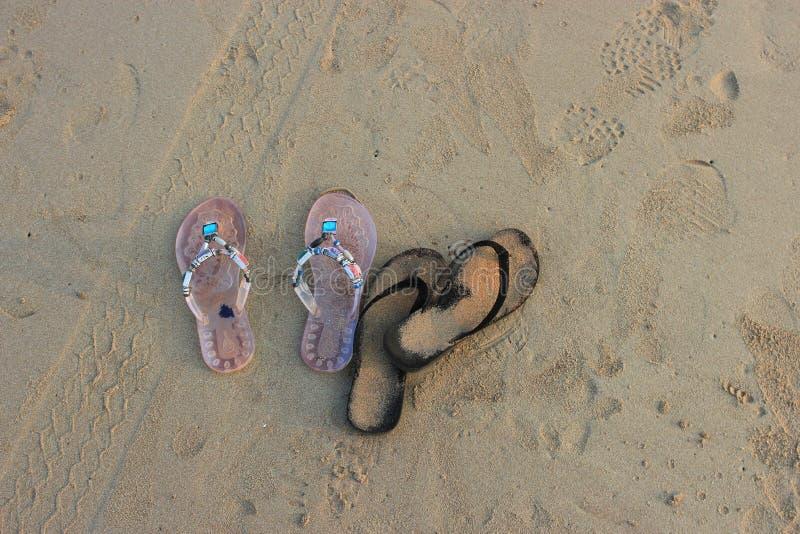 Beach, flip-flops for the sand. Goa, India. Beach, flip-flops for the sand royalty free stock photos