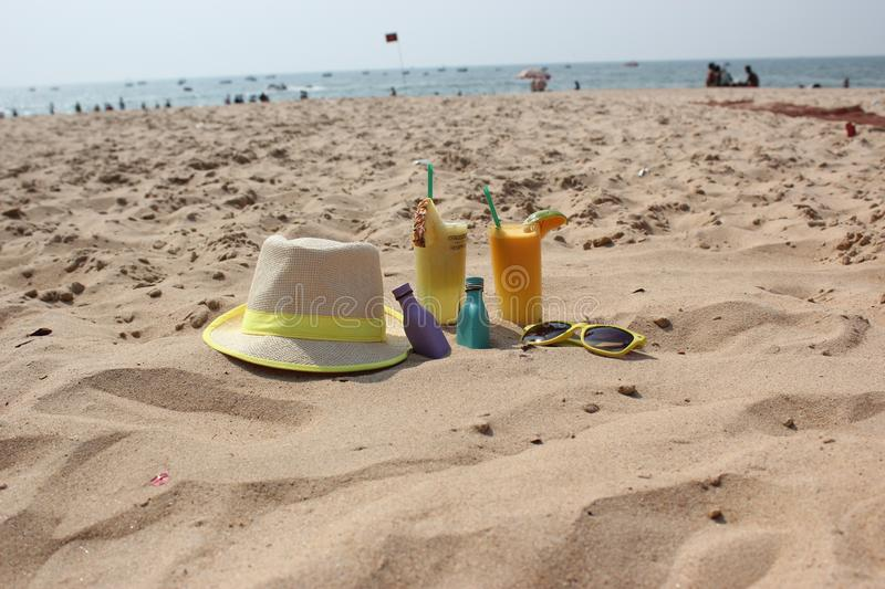 hat and cocktails on the sand royalty free stock photo