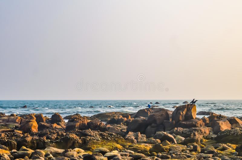 Goa Sea Beach view in clear bright sunny day from a far distance during daytime in clear blue sky on a sunny day. Photograph of Goa Sea Beach taken in Christmas royalty free stock photo