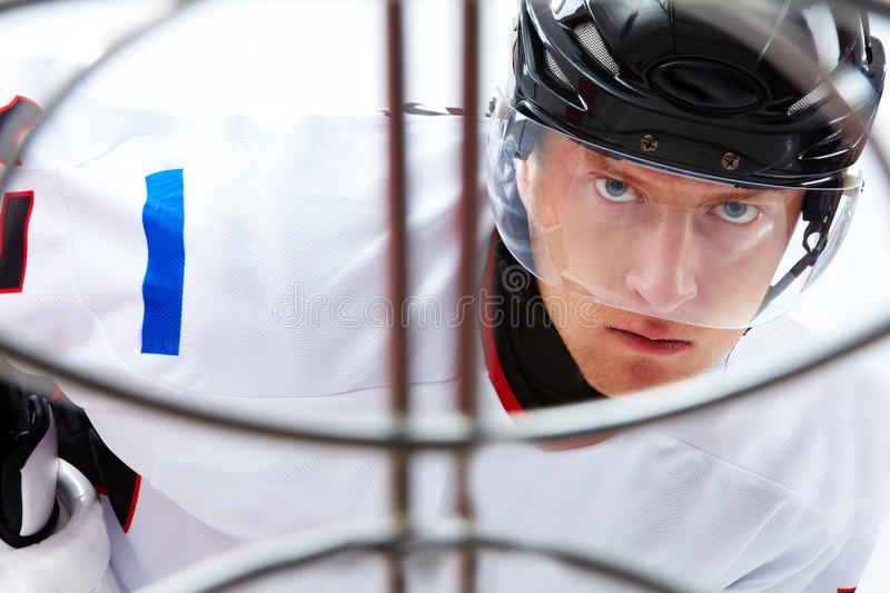 Before goal. Portrait of hockey player looking at adversary before making goal royalty free stock photos