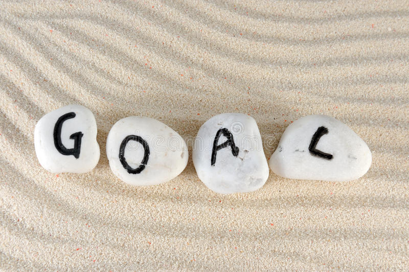 Goal. Word on group of stones on the sand royalty free stock photo