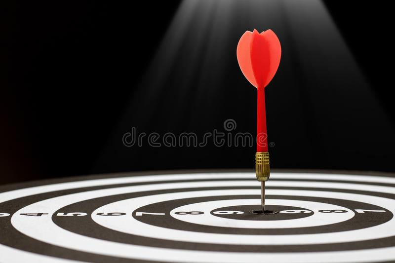 goal and achievement concept, red dart on center of number board stock photos