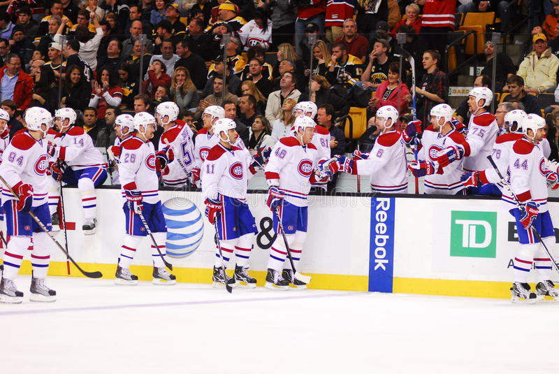 Goal Celebration. Members of the Montreal Canadiens congratulate each other after scoring a goal against the arch-rival Boston Bruins at TD Garden stock photo