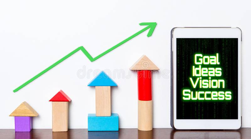 Goal Ideas Vision success concept on tablet. Toy block rise up with business planning stepping up diagram graph. Business concepts and strategy for success on stock image