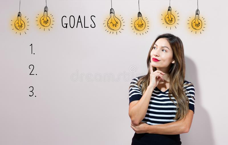 Goal list with young businesswoman stock photo