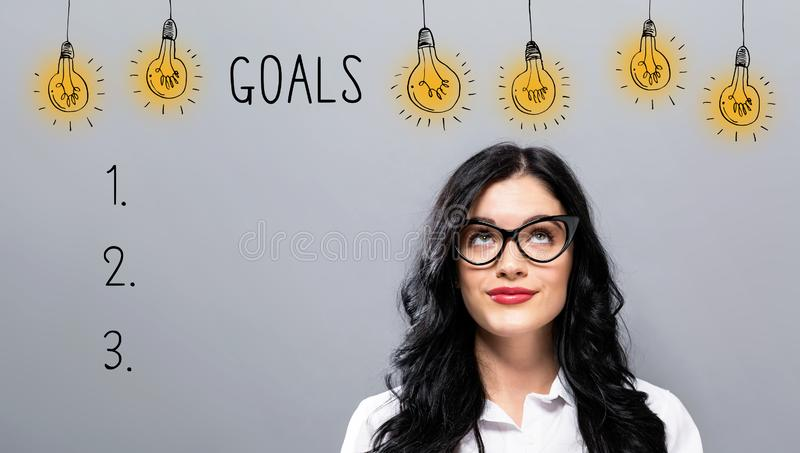 Goal list with young businesswoman stock images