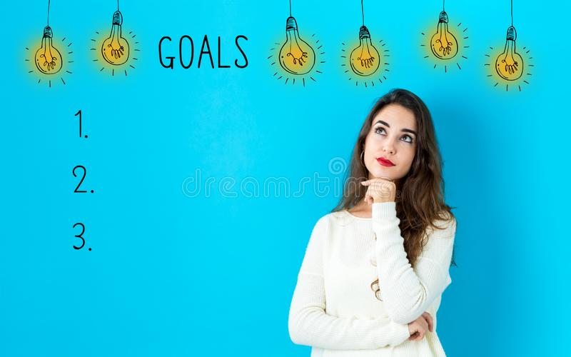 Goal list with young woman stock image