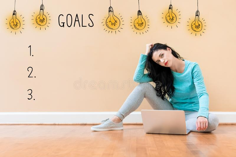 Goal list with woman using a laptop royalty free stock image