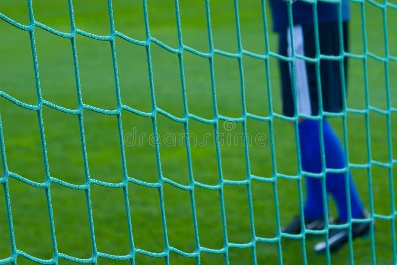 Goal net with goalkeaper. royalty free stock image