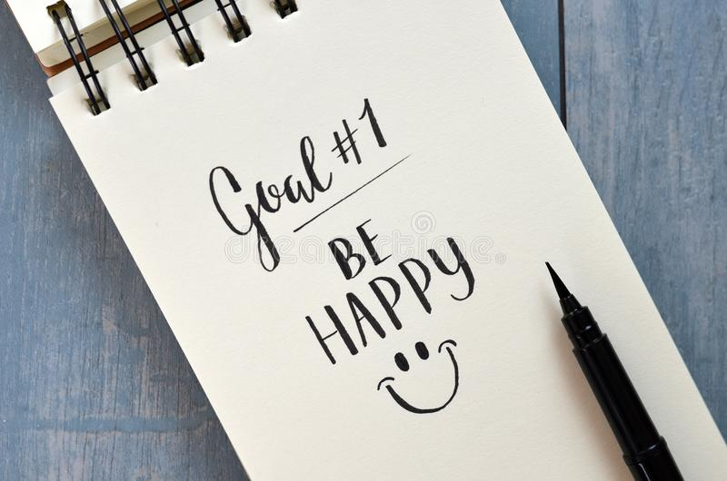 Goal No. 1 BE HAPPY hand-lettered in notepad stock photo