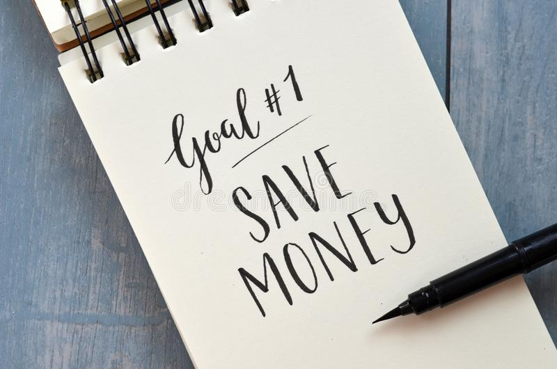 Goal No. 1 SAVE MONEY hand-lettered in notepad stock photos