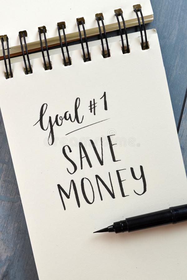 Goal No. 1 SAVE MONEY hand-lettered in notepad stock photography