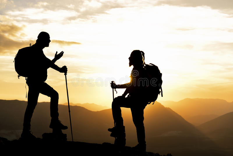 Goal setting and plan your route. Climbers have managed the impossible;summit route conversations.goal setting and plan your route stock photo