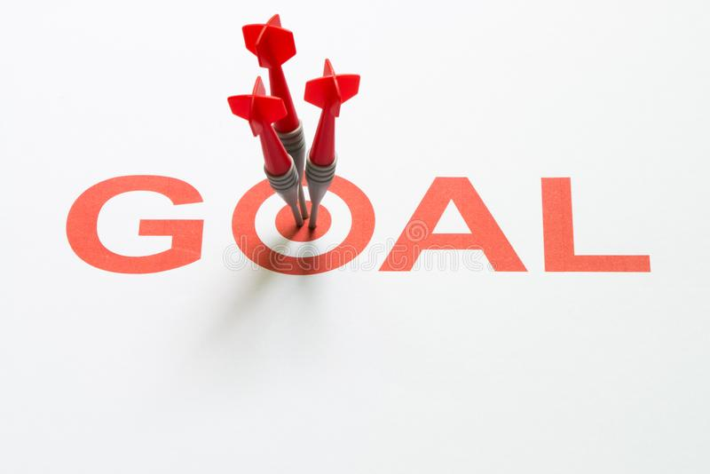 Goal text with dart on target stock image