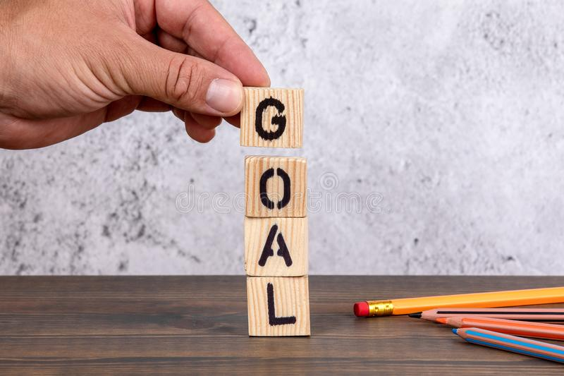 Goal. Wooden letters and pencils stock photo