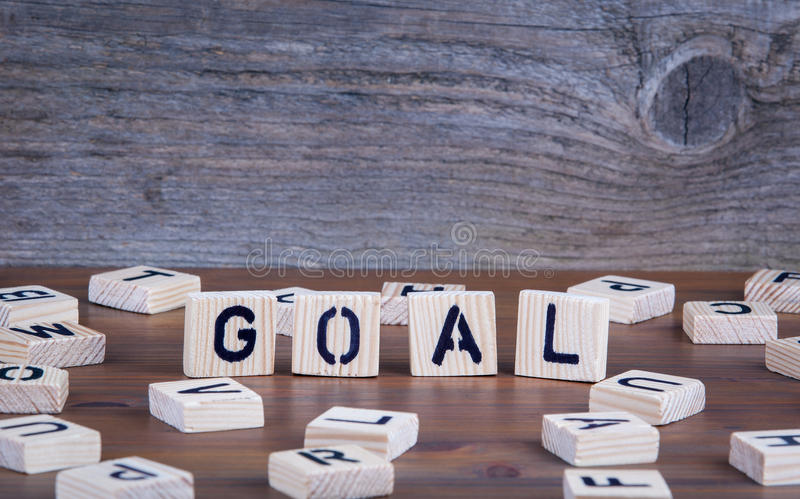 Goal from wooden letters on wooden background stock photos