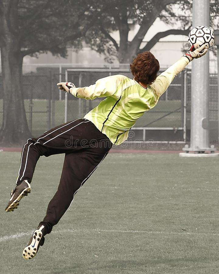 Goalee Player Holding Black and White Soccer Ball stock photos