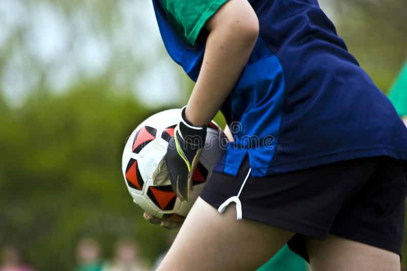 Goalie with Ball. Female goalie with the soccer ball stock photography