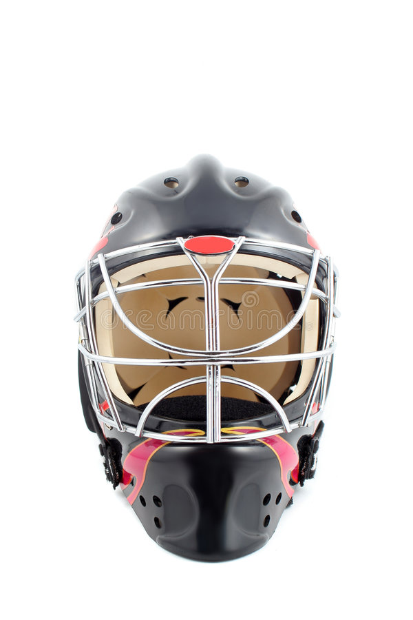 Goalie helmet. Black and red isolated hockey goalie mask royalty free stock photography