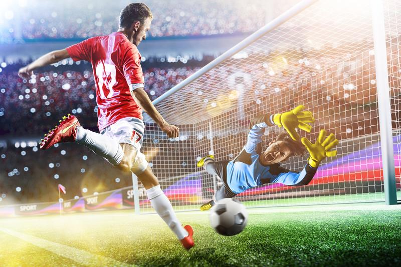 Goalkeeper catches the ball on the soccer stadium. Goalkeeper catches the ball on the football stadium stock image