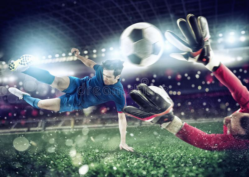 Goalkeeper catches the ball in the stadium during a football game. royalty free stock images