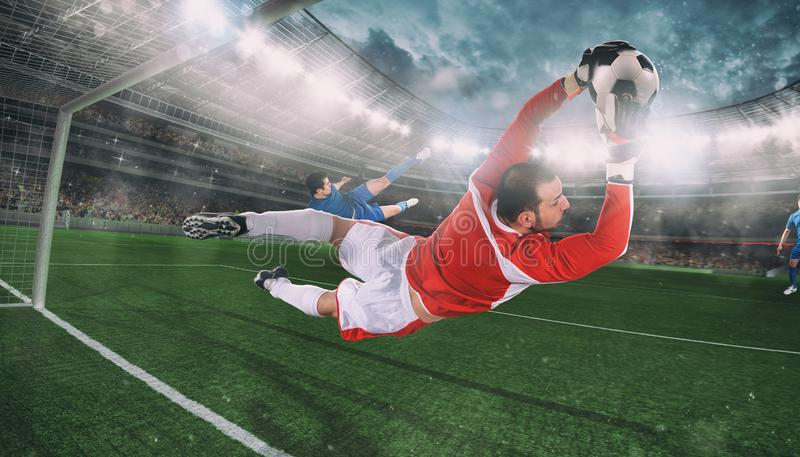 Goalkeeper catches the ball in the stadium during a football game stock photography