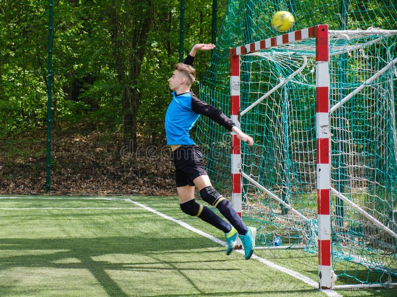 Goalkeeper catches the ball. Stadium goalie sports play ground game, grass soccer keeper man, outdoorsc ompetition, royalty free stock photo