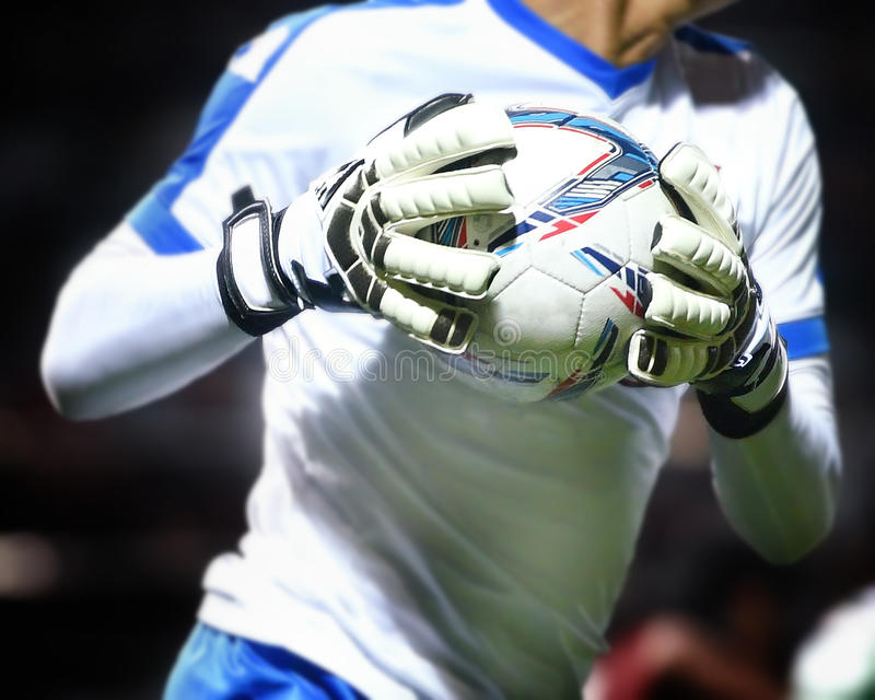 Goalkeeper catches soccer ball royalty free stock photography