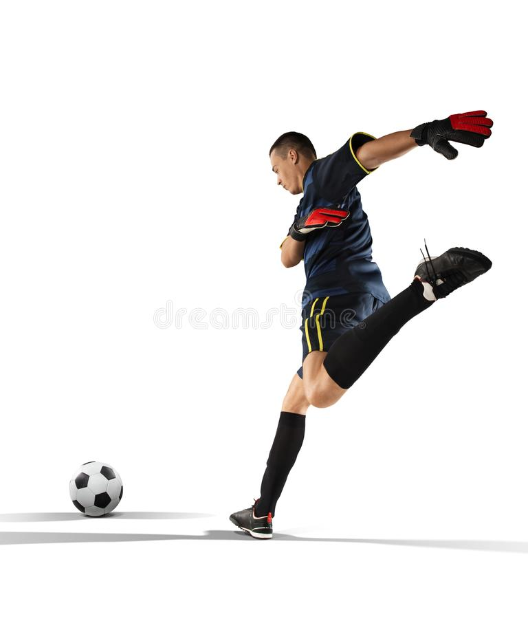 Goalkeeper kicking the ball in the isolated on white stock image