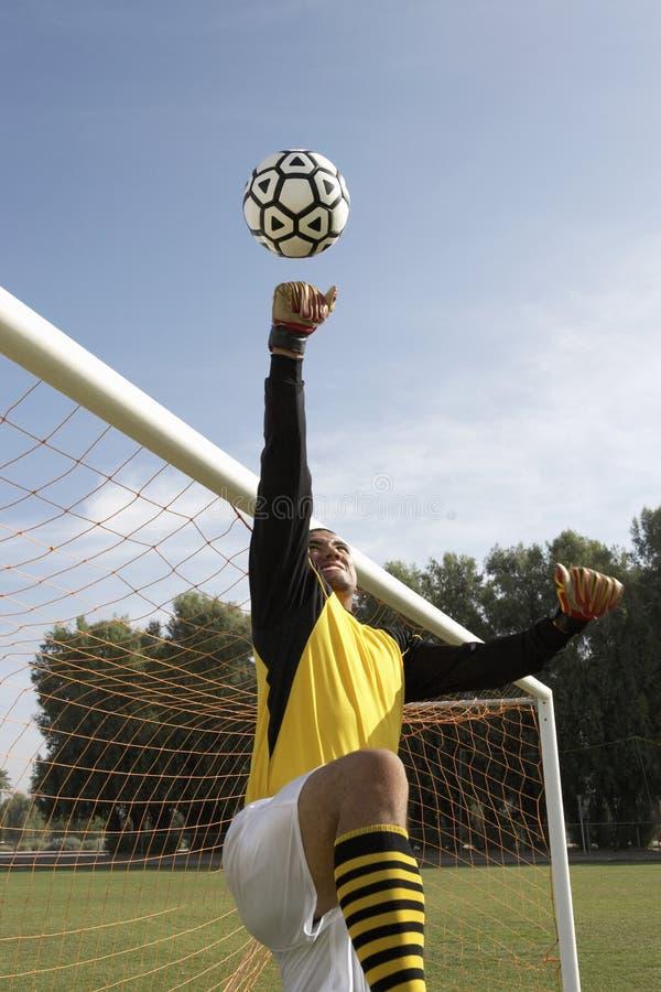 Goalkeeper reaching for ball stock photos