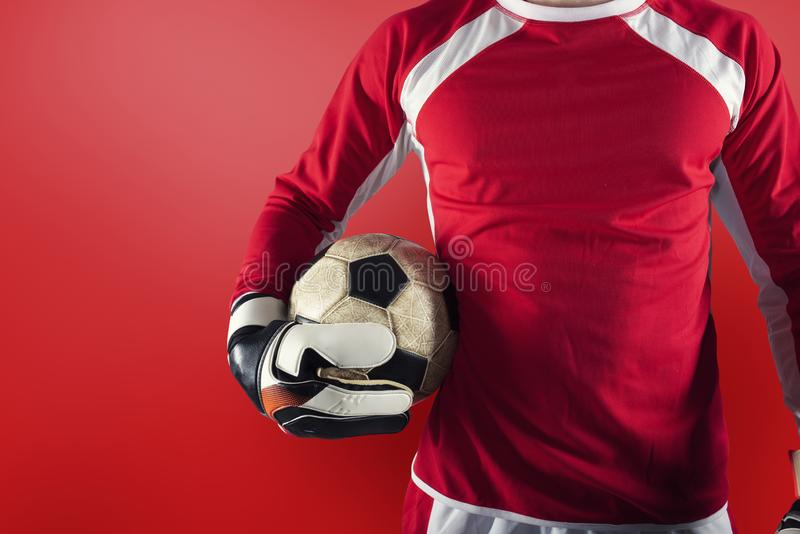 Goalkeeper ready to play with ball in his hands stock photography
