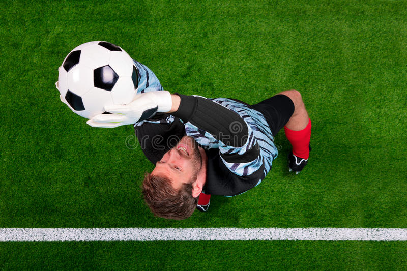 Goalkeeper saving the ball in the air. stock photo