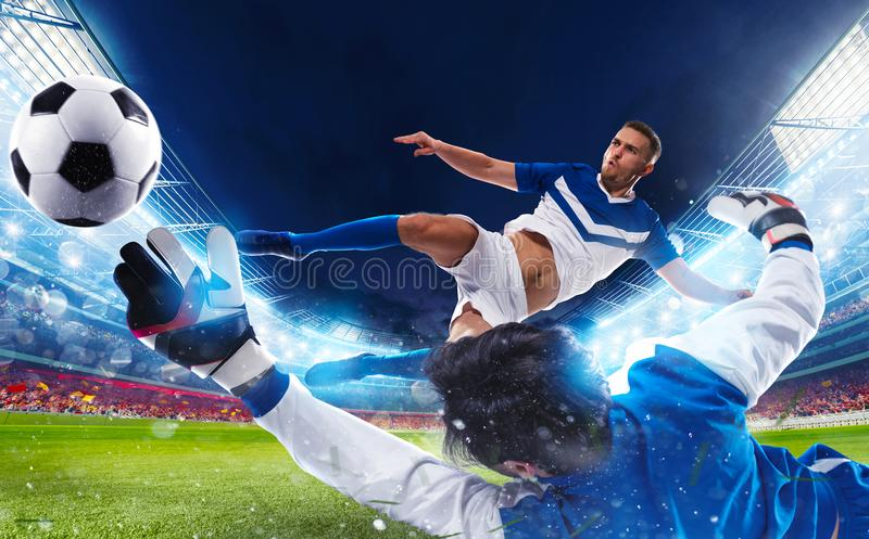 Goalkeeper tries to catch the ball in the stadium royalty free stock image