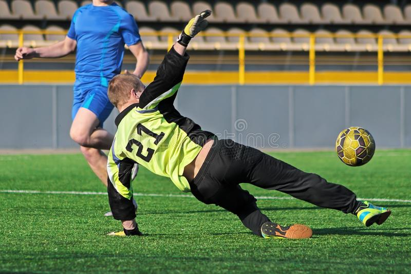 Goalkeeper try to catch soccer ball royalty free stock images