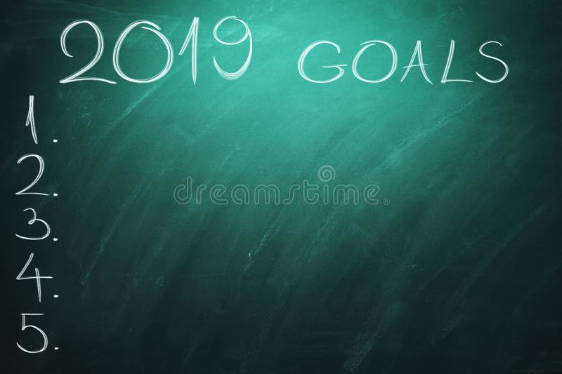 2019 Goals on green board. Chalkboard. New year - new business challenges. royalty free stock images