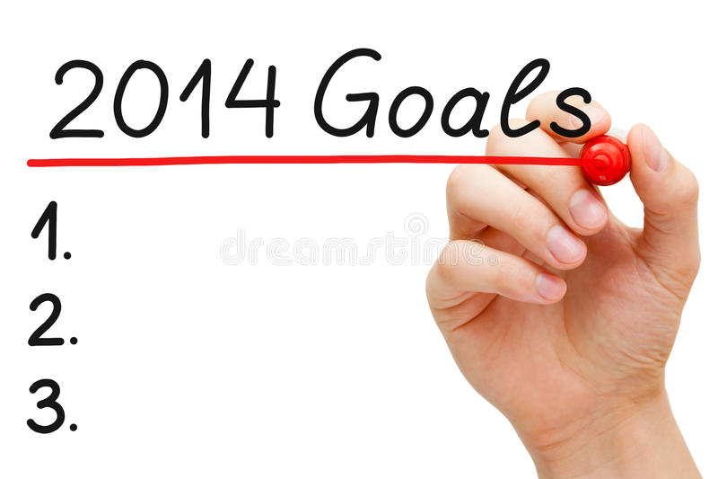 Goals 2014. Hand underlining 2014 Goals with red marker isolated on white royalty free stock photography