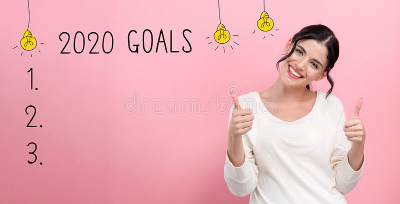 2020 goals with happy young woman stock photo