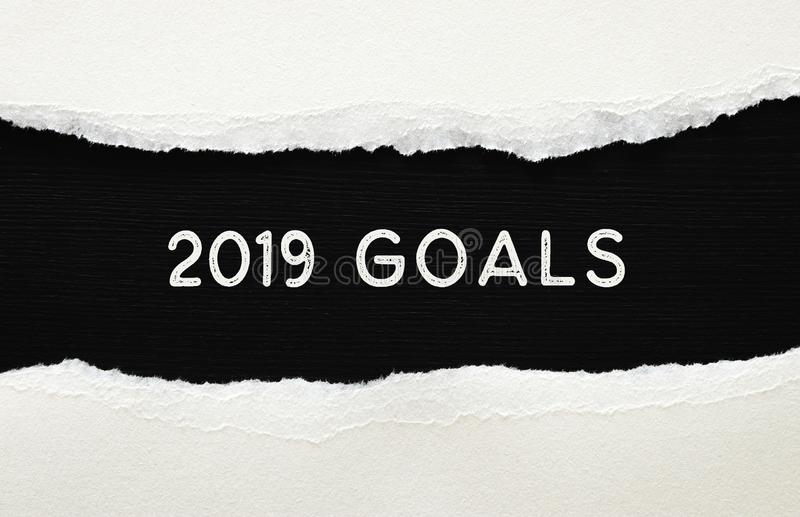 2019 goals list written over torn paper on black background. royalty free stock image