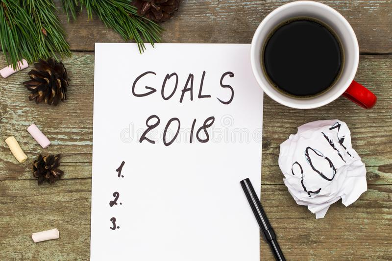 2018 goals on paper note book background and cup of coffee on royalty free stock photo