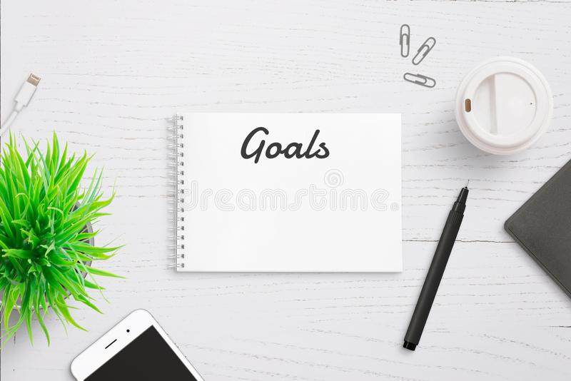 Goals text on notepad page header. Annual writing list stock photography