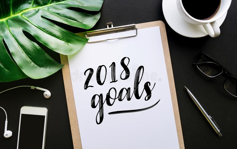 2018 goals text writing on notepaper and accessories royalty free stock image