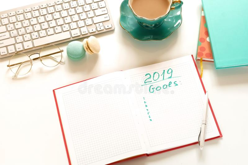 Goals 2019, To do list concept .top view, flat lay women`s office desk. stock image