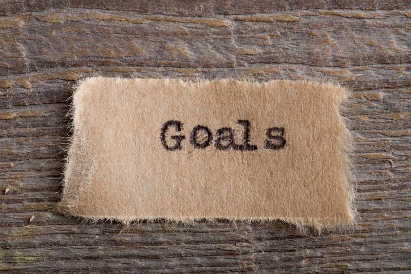 Goals word on a piece of paper close up, business creative motivation concept. Success, corporate, typewriter, creativity, inspiration, plan, positive stock image