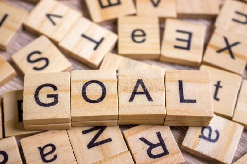 Goals Word In Wooden Cube. Sign with wooden cubes royalty free stock images