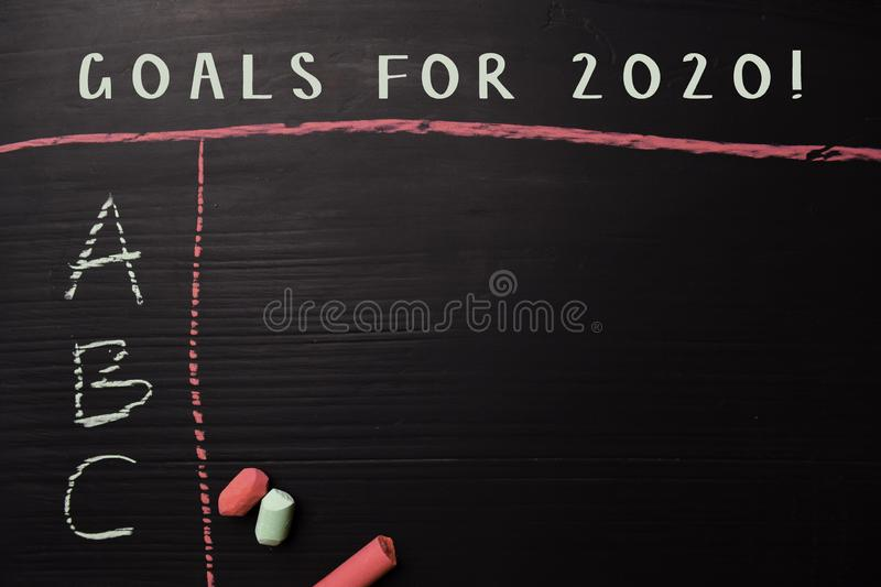 Goals For 2020! written with color chalk. Supported by an additional services. Blackboard concept stock image
